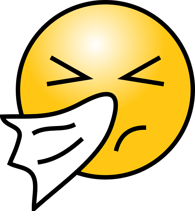An emoji of a person who is sick and blowing their nose.